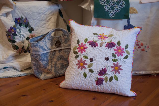 Items from Burra Quilters display in the Bence Room, centre stage Karen Baums' circle of flowers cushion.