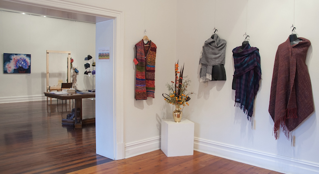 View from Annex into Main Gallery showing Helen Moon's Knitted Coat of hand painted silk strips $350, and three woven wool shawls by Bev Bills, from left: and Twilled Boucle - $85, Threads - $150, Wrap Up - $170