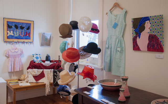 Selection of vintage hats, Ronda Dunstan's Sentimental Assemblage and gumnut pottery, and, next to a crisp cotton vintage dress Meg Mader's painting Daphne, $150.