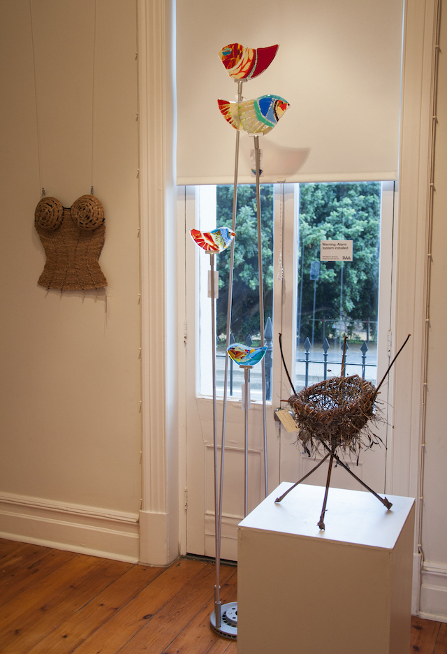 Merea Tsatsoronis' Corset, $90, glass birds by Lynn Elzinger Henry viewing one of Burra's beautiful carob trees from the window and Laima Guscia's A Weave on the Wild Side, $120, made from sticks and seaweed.